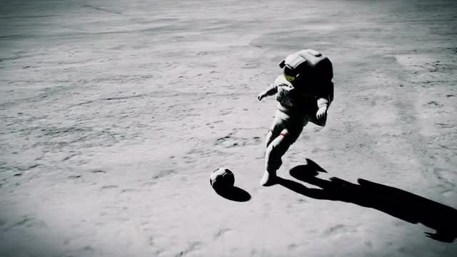 Two Astronauts Play Moon Football: Stock Motion Graphics