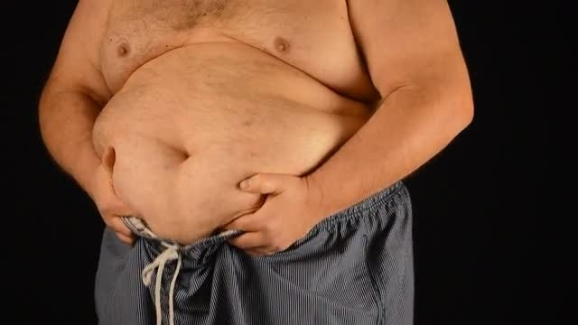 Obese Man Checks His Belly: Stock Video