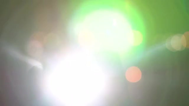 Bokeh Lights And Lens Flare: Stock Video