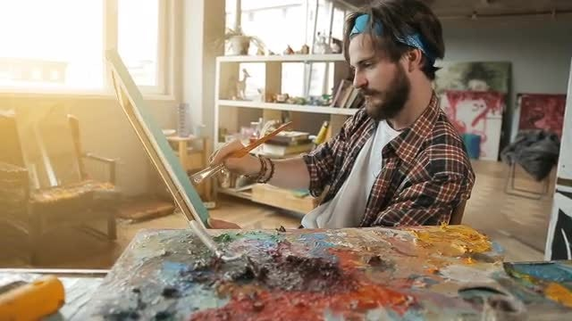 Male Artist Paints Picture: Stock Video