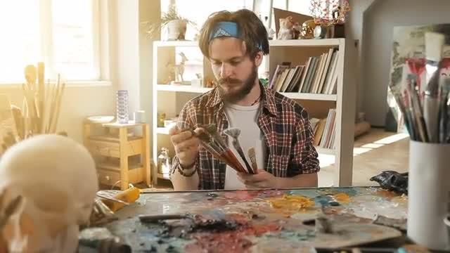Painter Feels Paintbrushes: Stock Video