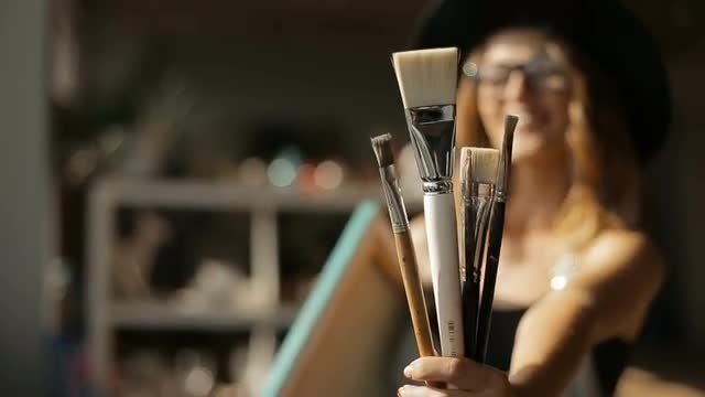 Female Artist Shows Paintbrushes: Stock Video