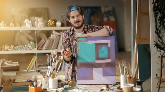 Artist Educates Others About Painting: Stock Video