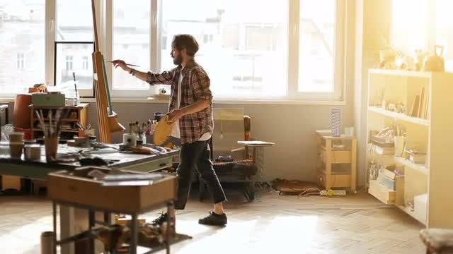 Man Paints A Picture: Stock Video