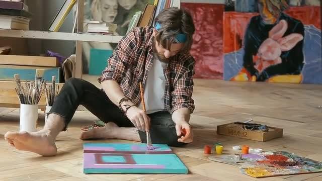 Artist Applies Purple Colour: Stock Video