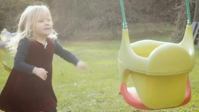 Toddler Playing With Swing Set: Stock Video