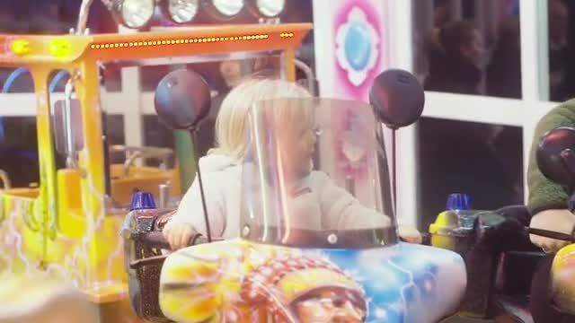 Happy Toddler On A Carousel: Stock Video