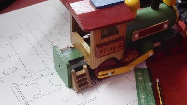 Toy Train With Construction Plans: Stock Video