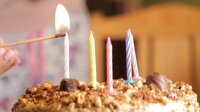 Lighting Up Birthday Cake Candles Stock Video