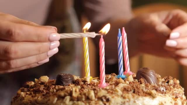 Woman Lighting Up Birthday Candles Stock Video