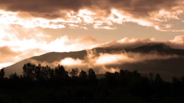 Clouds over a mountain: Stock Video