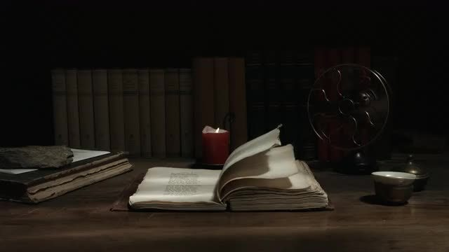 Old Book On The Table: Stock Video