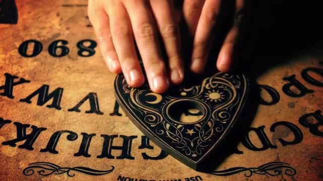 Person Uses An Ouija Board: Stock Video