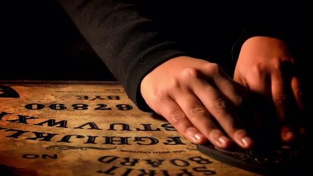 Man Uses Ouija Board: Stock Video
