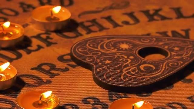 Ouija Spirit Board Spinning Slowly: Stock Video