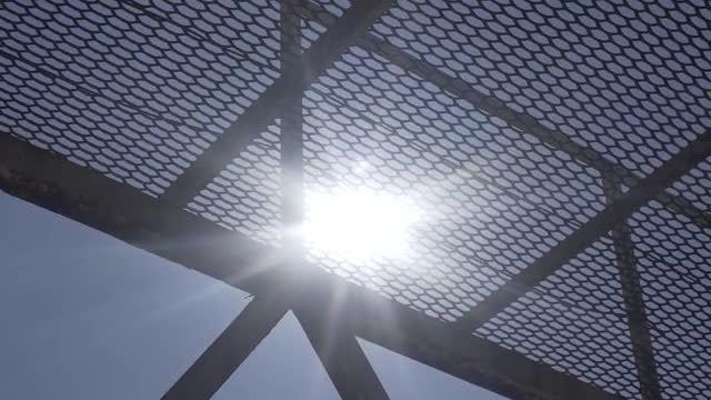 Sun Through Metal Grate: Stock Video