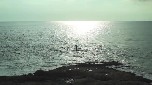 Man Paddle Boarding: Stock Video