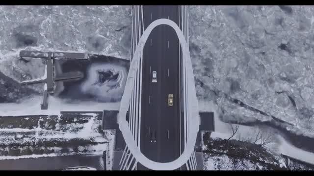Bridge Over Frozen River: Stock Video