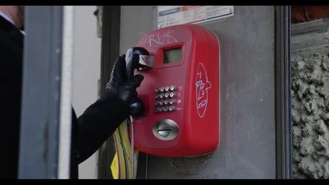 Man Uses Public Phone: Stock Video