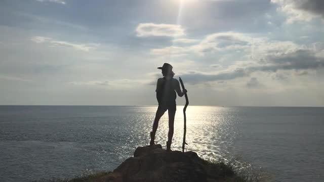 Hiker On Rock By Ocean: Stock Video