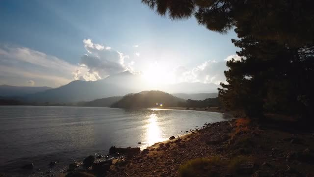Sunset Over Rocky Shores: Stock Video