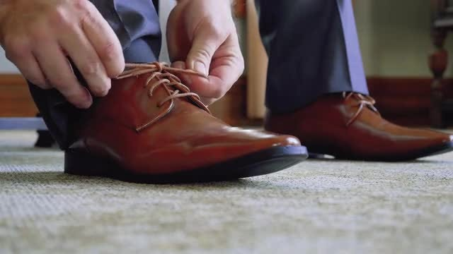 Man Tying Dress Shoes: Stock Video