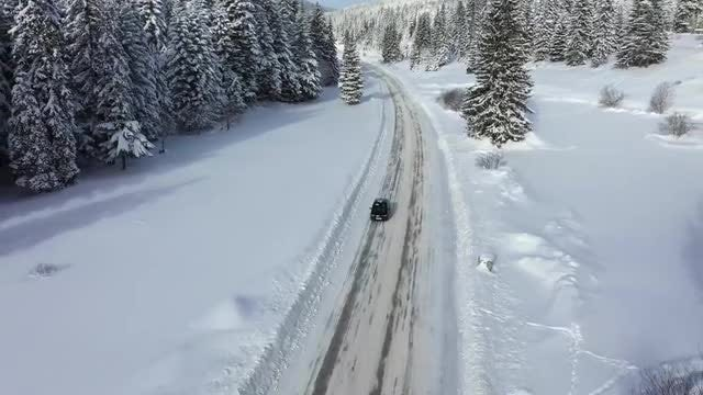 Car On Road With Snow: Stock Video