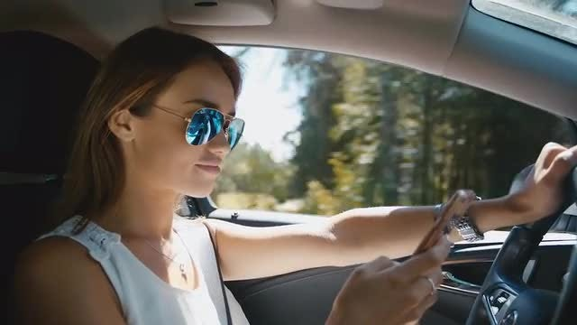 Texting While Driving: Stock Video