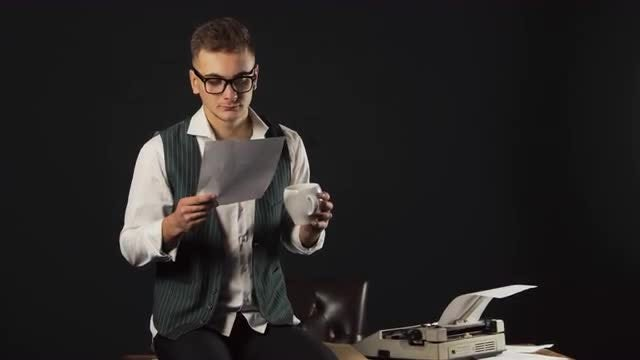 Man Reads A Paper With Coffee: Stock Video