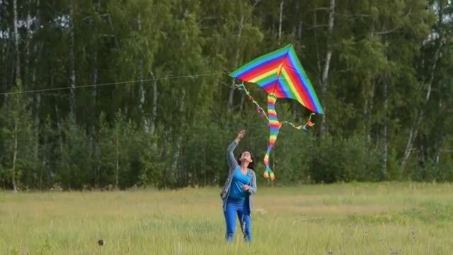Woman Flying Rainbow Kite: Stock Video