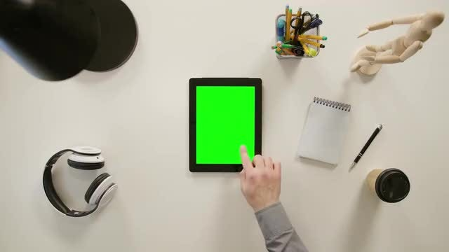A Finger Touching A Tablet: Stock Video