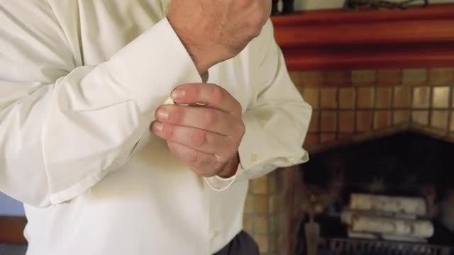 Man Buttoning His Shirt: Stock Video