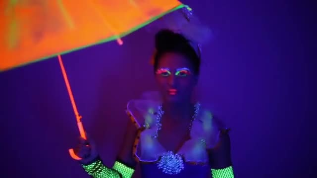 Lady With Neon Umbrella: Stock Video
