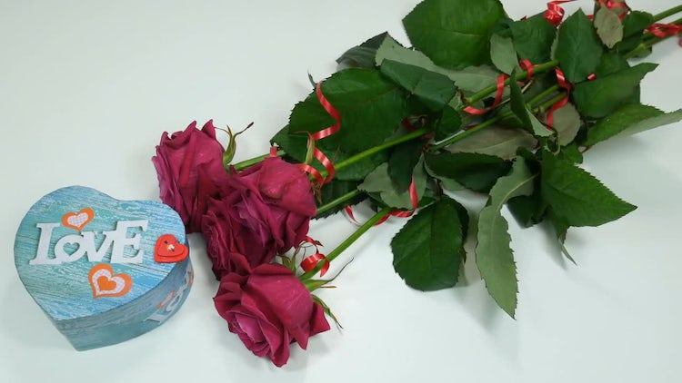 Roses And A Gift: Stock Video