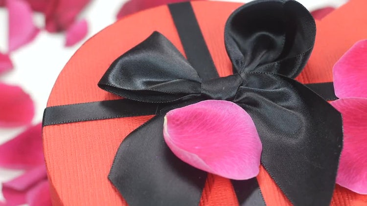 Gift Box With Rose Petals: Stock Video