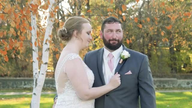 Bride Adjusts Groom's Boutonniere: Stock Video