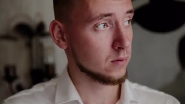 Man Puts On Cufflinks: Stock Video