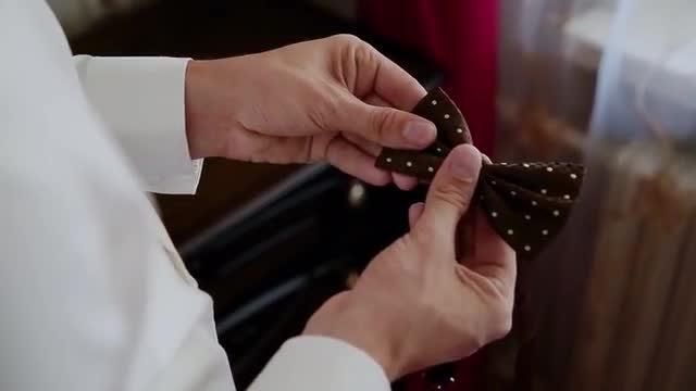 Man Adjusts Bowtie: Stock Video