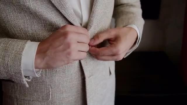 Businessman Buttoning Blazer: Stock Video