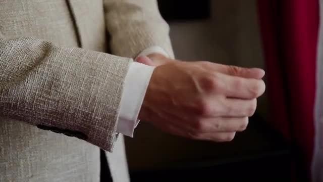 Straightens Sleeves: Stock Video