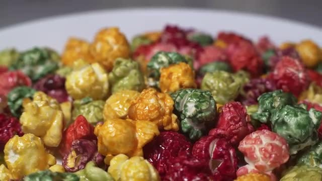 Rotating Colored Popcorn: Stock Video