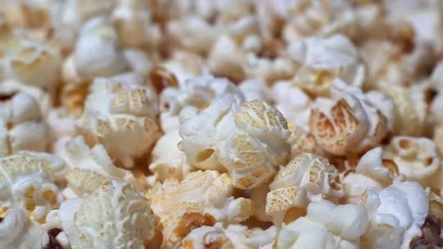 Rotating Popcorn With Caramel: Stock Video