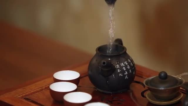 Woman Prepares Chinese Tea: Stock Video