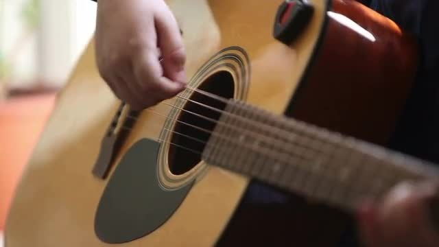 Boy Playing The Guitar: Stock Video
