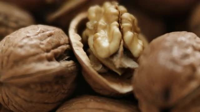 Fresh Walnuts On Table: Stock Video