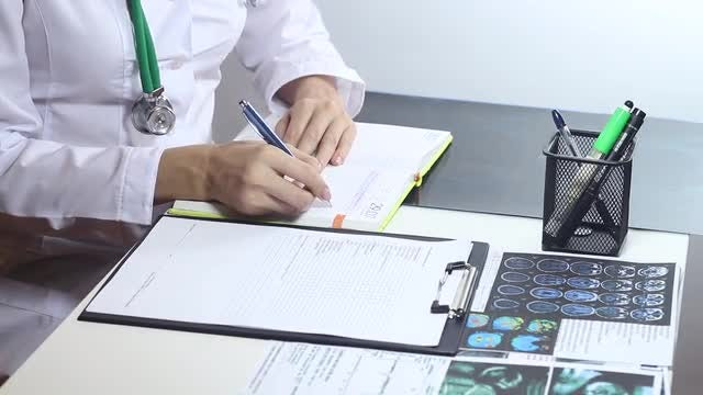 Doctor Making Notes: Stock Video