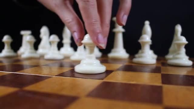 Arranging Chessboard Pieces: Stock Video