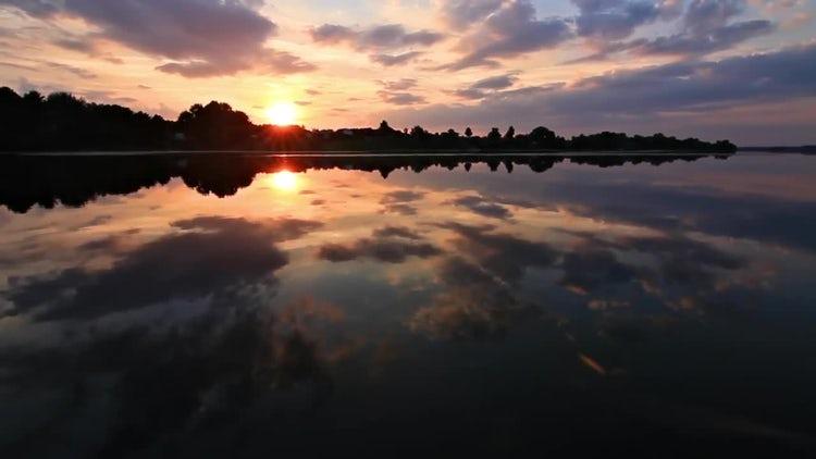 Sun Sets Over Lake: Stock Video