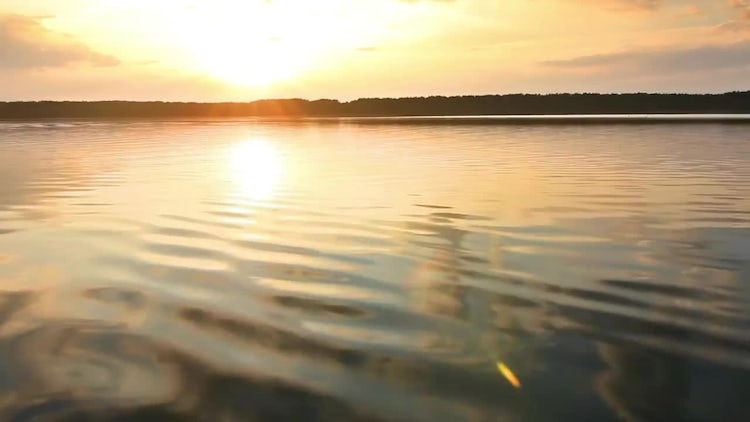 Sunset Over A Calm Lake: Stock Video