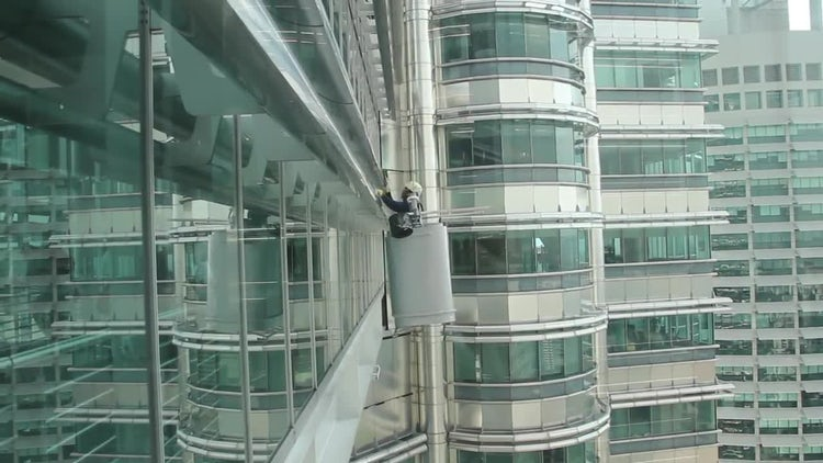 Window Washer Cleans Glass: Stock Video